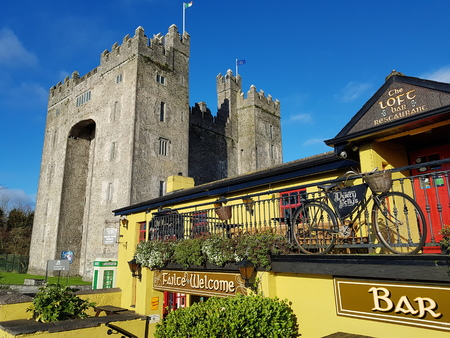 Bunratty Castle and Durty Nellys Irish Pub, Ireland - Nov 30th 2017: Beautiful view of Irelands most famous Castle and Irish Pub in County Clare. Famous world tourist attraction. Bunratty Castle and Durty Nellys Pub.