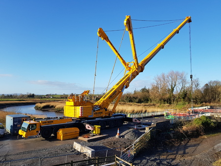 Ennis Ireland - Dec 11th 2017: Large mobile crane working on motorway bridge removal and construction.