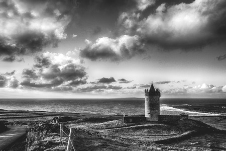 epic black and white Doolin Castle in County Clare, Ireland. scenic irish countryside along the wild atlantic way Editorial