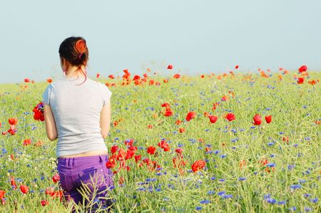 oudoors: Woman collecting flowers Stock Photo
