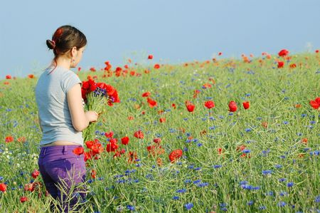 oudoors: Girl collecting flowers Stock Photo
