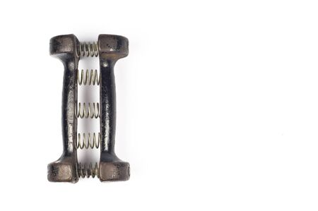 Old cast iron dumbbell carpal expander with springs on white background