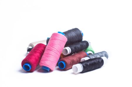 Colored spools of thread Imagens