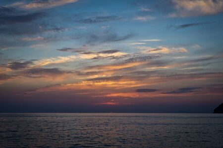 The sun disappearing behind the sea. Sunset over the black sea
