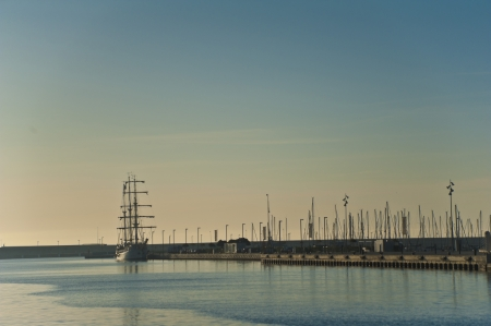 A big ship in the port of Valencia in the morning sun  photo