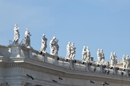 colonade: Sculptures of the colonade in St Pietro square in Rome,Italy  Stock Photo