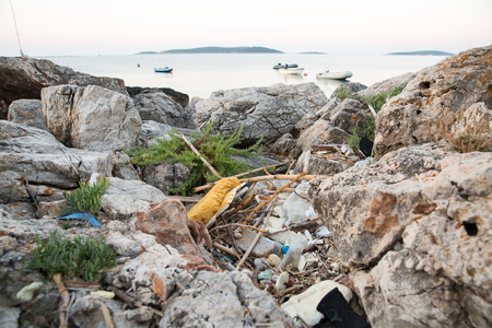 decompose: Heap of trash beside the sea. Concept photo of pollution problem of the sea and nature, which effects sea life like turtles. Plastic needs up to 450 years to decompose.
