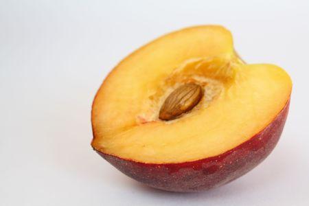 velvety: half of velvety peach with open seed Stock Photo