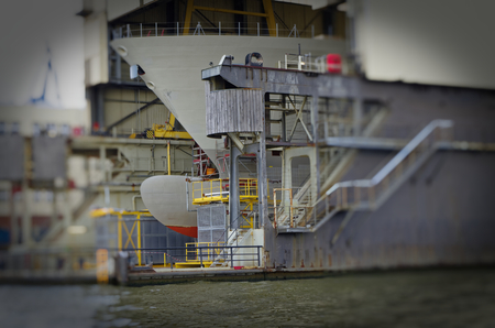 Dry dock or shipyard with ship at Hamburg harbor at repair work in Hamburg in Germany Europe
