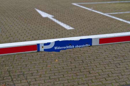 Barrier of a parking lot with the inscription in German language illegally parked in German parked illegally Stok Fotoğraf