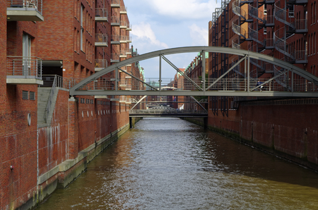 Hamburg Speicherstadt in the HafenCity as a World Heritage Site and historic brick building with Brückein Germany Europe