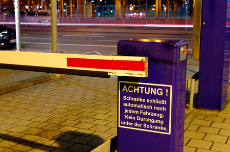 Barrier of a parking lot with the inscription in German language