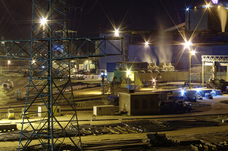large steel hat in Germany in the production of steel girders overlooking the shed and a power pole