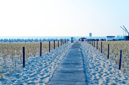 Beach on the German Baltic Sea with beach chair and holiday feeling with sand Standard-Bild - 104620547