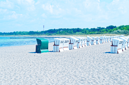 Beach on the German Baltic Sea with beach chair and holiday feeling with sand Standard-Bild - 104620554