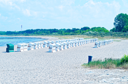 Beach on the German Baltic Sea with beach chair and holiday feeling with sand Standard-Bild - 104620648