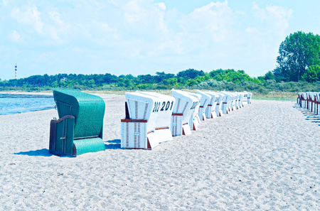 Beach on the German Baltic Sea with beach chair and holiday feeling with sand Standard-Bild - 104620662