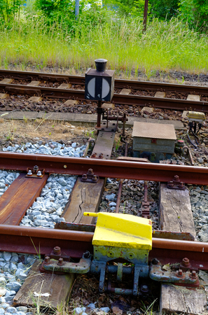 Railway tracks in the countryside with track bed. Gravel and switch at a railroad crossing Stock Photo