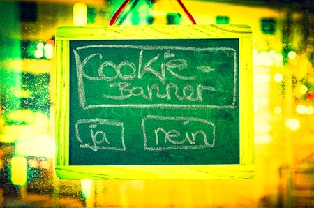 Blackboard with inscription cookie banner and padlock