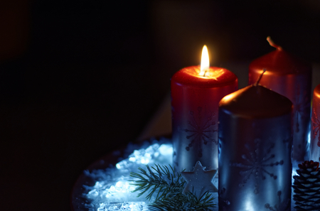 Advent wreath in red gold candles with snow as background and not yet lit candles 写真素材