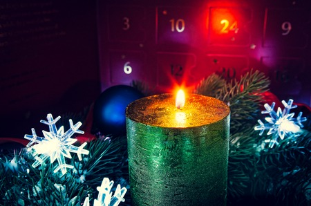 Advent wreath in candles with snow as background and advent calendar