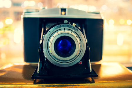 Old retro camera with blue lens and bellows Stock Photo