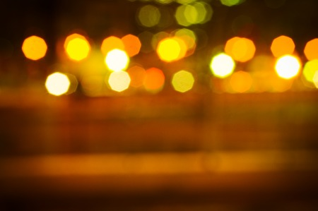 Background of a street with lights at night out of focus