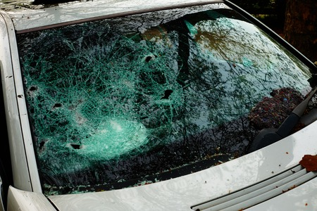 Car in which the disc was hit and all internal parts were stolen with broken glass and broken disc Standard-Bild - 124811584