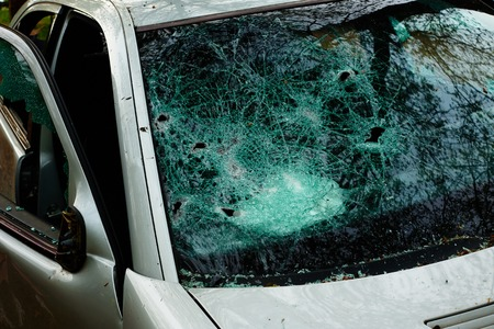 Car in which the disc was hit and all internal parts were stolen with broken glass and broken disc Standard-Bild - 124811593