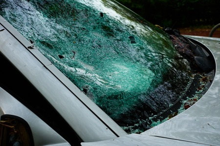 Car in which the disc was hit and all internal parts were stolen with broken glass and broken disc Standard-Bild - 124811596