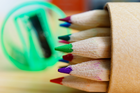 Crayons of wood with green pencil sharpener Standard-Bild - 124811597