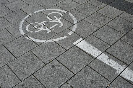 Bike path with red graffiti Standard-Bild - 124811618