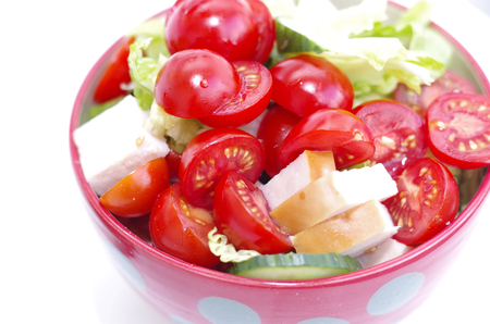 Fresh crunchy vegetables with tomato sliced radish cucumber and peppers as a salad Standard-Bild - 124811625