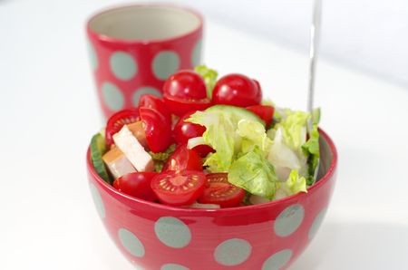 Fresh crunchy vegetables with tomato sliced radish cucumber and peppers as a salad Standard-Bild - 124811629