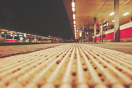 Station in Germany at night with escalator and platform and lights to illustrate the rail traffic Standard-Bild - 124811636