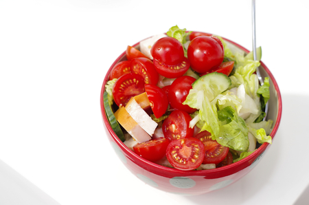 Fresh crunchy vegetables with tomato sliced radish cucumber and peppers as a salad Standard-Bild - 124811647