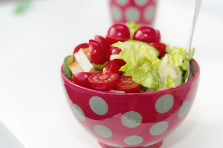 Fresh crunchy vegetables with tomato sliced radish cucumber and peppers as a salad Standard-Bild - 124811648