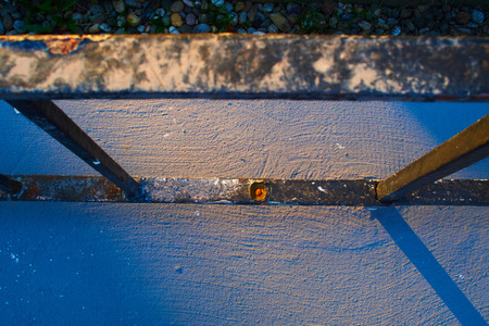 Railing of a house on the sidewalk with rust Standard-Bild - 124811658