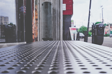 Bench of a bus stop with steel sheet and holes Standard-Bild - 124811661