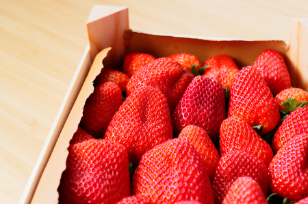 Strawberries freshly harvested in a wooden box, beautiful red and fresh Standard-Bild - 124811672
