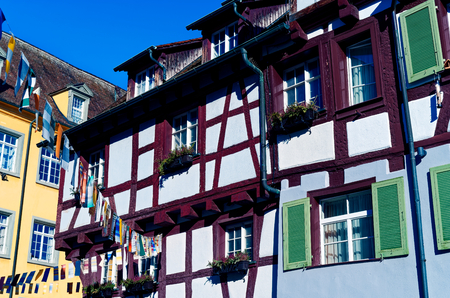 Old mill with half-timbered house next to a city wall on Lake Constance