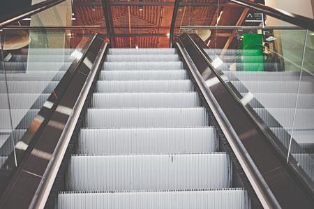 Escalator in a shopping mall in cool stylish look Standard-Bild - 124811689