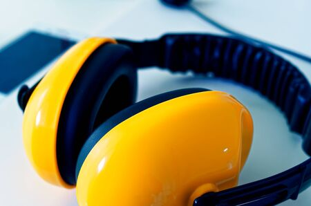 yellow earmuffs to clarify construction noise and noise