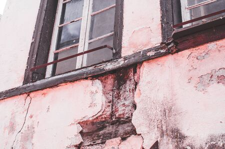 Ruin of a large brick house after a fire in the attic to clarify fire damage Arson theft and vandalism 写真素材