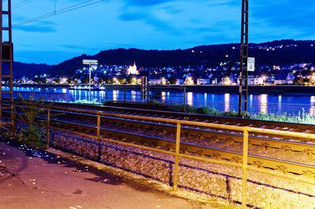 Kamp-Bornhofen with Rhine with railway line and boat dock in Rhineland-Palatinate Germany Europe photographed on 2019.08.15