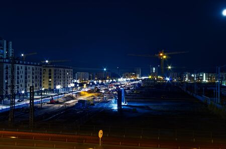 Frankfurt construction site of Europaallee at night with railroad tracks and trains photographed on 04.25.2015 Stock fotó