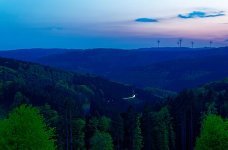 Odenwald at Kortelshütte with sunset and wind turbines