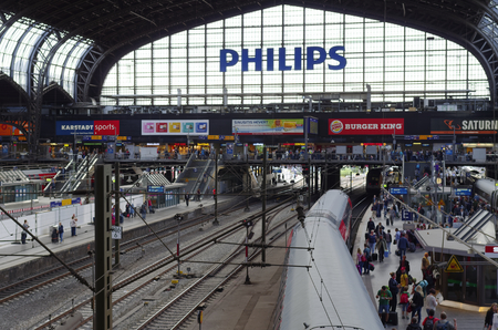 Hamburg central station interior view with railroad tracks and trains photographed on 2016.08.29