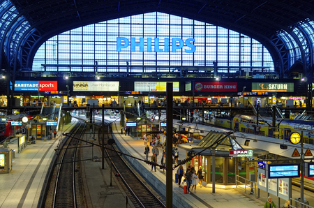 Hamburg central station interior view with railroad tracks and trains photographed on 2017.07.10