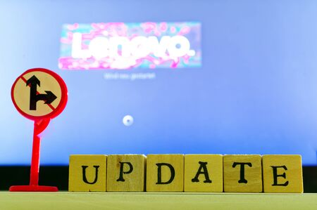 Font update with update process in the background during the configuration of the computer with lettering Lenovo Stock fotó